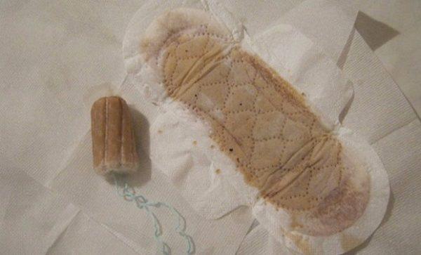 Женская прокладка с коричневатыми выделениями